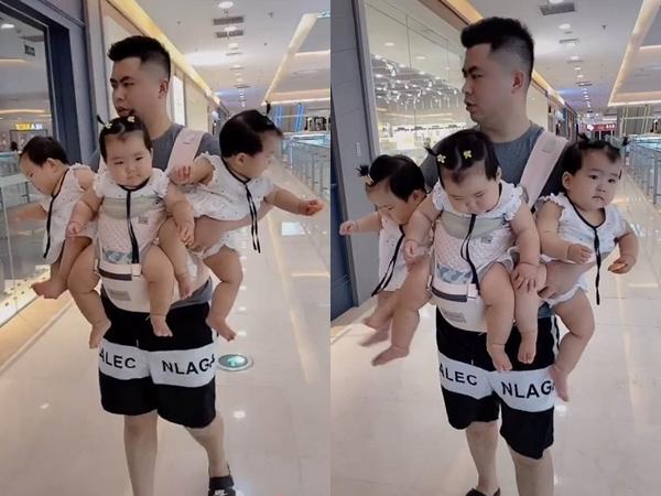 Hình ảnh ông bố 'ba đầu sáu tay' đưa các con đi chơi trung tâm thương mại khiến người xem ngưỡng mộ và phục lăn - Ảnh 1