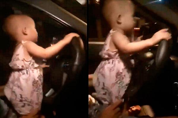 Clip bé 2 tuổi cầm vô lăng ô tô chạy băng băng trên quốc lộ ở Hà Tĩnh - Ảnh 1