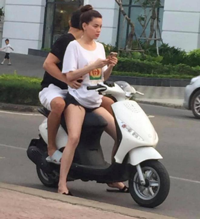 Hồ Ngọc Hà chở Kim Lý bằng xe máy mà không đội mũ bảo hiểm gây tranh cãi - Ảnh 1
