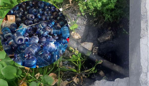 Lấy trực tiếp nước từ mương nước thải sinh hoạt để sản xuất nước uống đóng bình - Ảnh 2