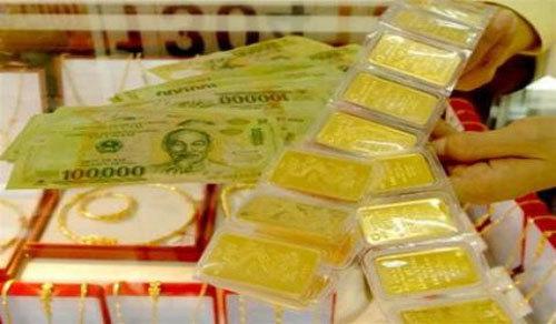 Giá vàng hôm nay 18/1: Ồ ạt mua vàng, tích USD - Ảnh 1
