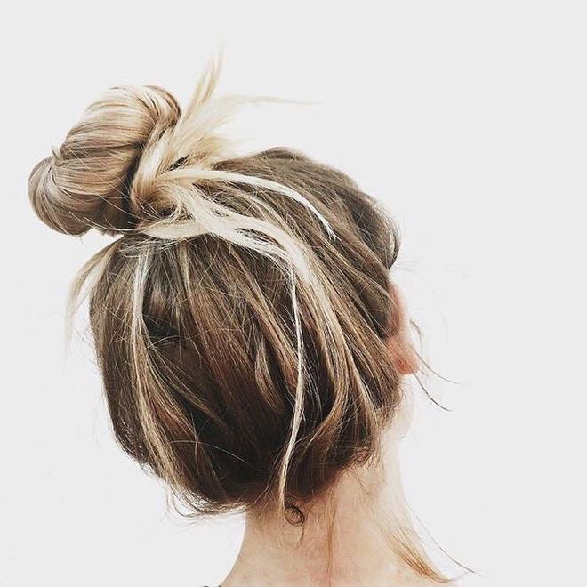 Tín đồ thời trang thế giới lăng xê kiểu tóc búi cao lộn xộn - Ảnh 2
