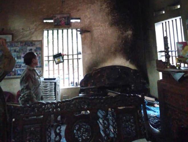 Cãi nhau, con gái chốt cửa, tạt xăng thiêu sống cha mẹ già ở Hà Nam - Ảnh 2