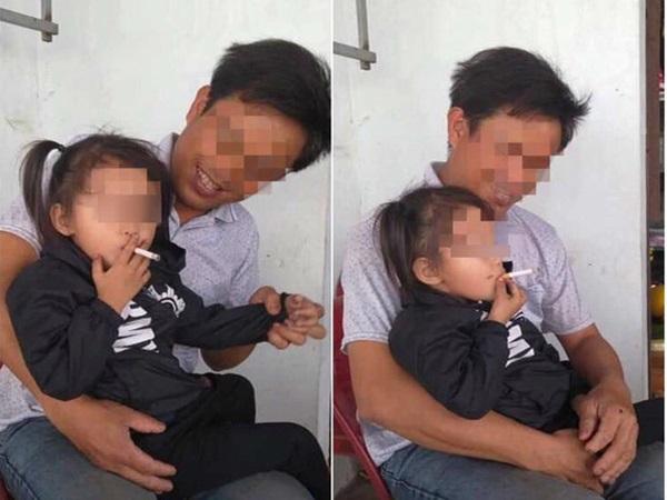 Bức ảnh người đàn ông cười vui vẻ nhìn bé gái cầm thuốc hút khiến nhiều phụ huynh bức xúc - Ảnh 1