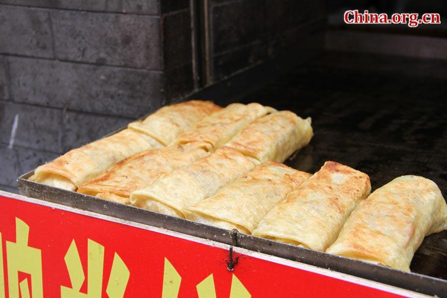 Đến Bắc Kinh nhất định phải dạo phố thử hết những món ăn vặt này - Ảnh 1