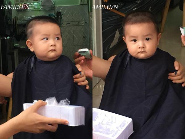 Bị cả nhà 'đè' ra cắt tóc, bé trai gây cười với biểu cảm cực căng thẳng nhưng ai cũng tấm tắc khen vì điều này - Ảnh 1