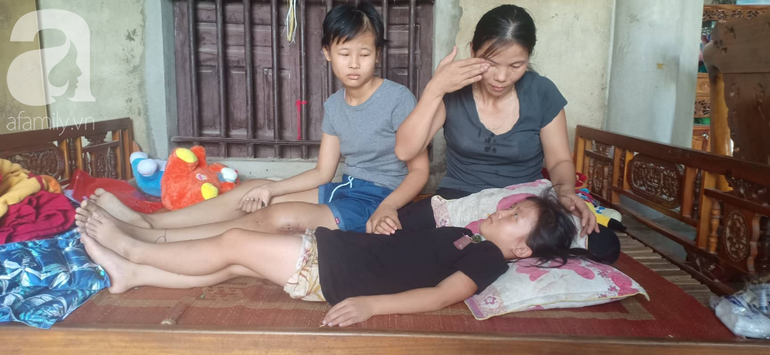 Tâm sự xót xa của bé gái 13 tuổi bị ung thư xương: 'Em con bị bướu cổ, con cưa chân rồi sao chăm sóc được em' - Ảnh 1