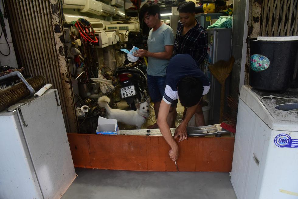 Những hình ảnh Sài Gòn mênh mông biển nước - Ảnh 9