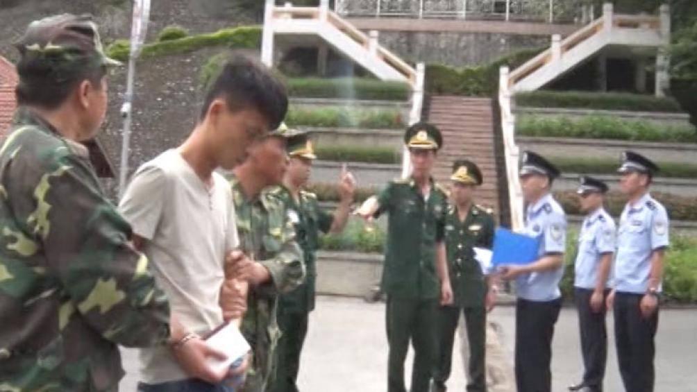 Bàn giao 11 người Trung Quốc lừa đảo bằng công nghệ cao - Ảnh 1