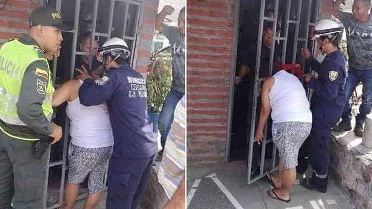Ngó nghiêng nhà hàng xóm, phụ nữ bị mắc kẹt đầu vào song cửa - Ảnh 1