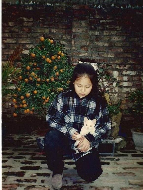 Hé lộ loạt ảnh hiếm lúc nhỏ của Hoa hậu Ngô Phương Lan - Ảnh 8