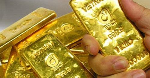 Giá vàng hôm nay 8/1: USD tụt giảm, vàng tìm đỉnh mới - Ảnh 1