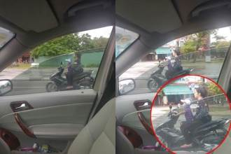 Bé trai 5 tuổi lái xe máy chở người phụ nữ phía sau khiến người đi đường đứng tim