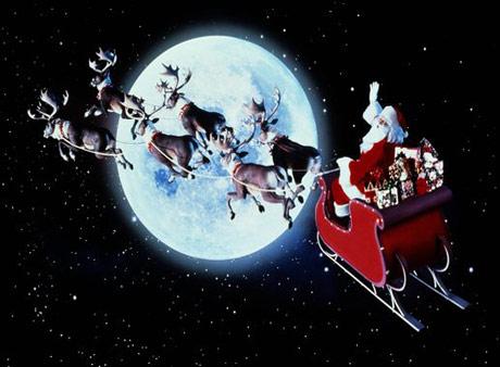 Ông già Noel cùng những chú tuần lộc đi tặng quà cho trẻ