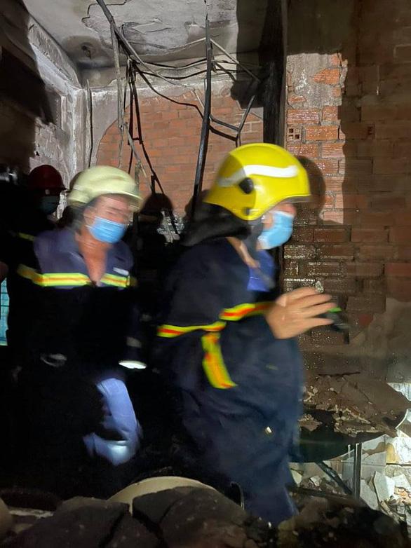 Xót xa hiện trường kinh hoàng của vụ cháy khiến 8 người tử vong ở TP.HCM - Ảnh 1