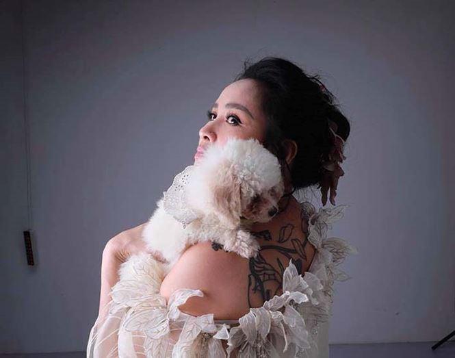 Thanh Lam lần đầu để lộ hình xăm bí ẩn khủng khiếp trên lưng - Ảnh 1