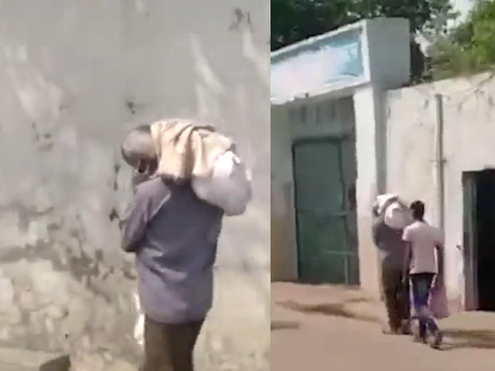 Sốc với clip người cha vác thi thể con gái 11 tuổi nhiễm Covid-19 đi hỏa táng ở Ấn Độ - Ảnh 1