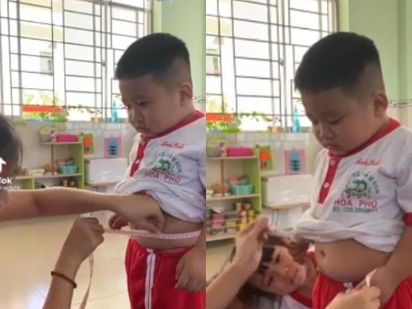 Clip cậu bé hóp bụng nín thở để cô giáo đo eo khiến CĐM cười nghiêng ngả