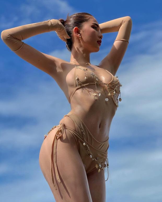 Ngọc Trinh mặc bikini chỉ che phần nhạy cảm, lại còn chú thích: 'Anh có thể làm ướt mọi thứ trên người em'. - Ảnh 5
