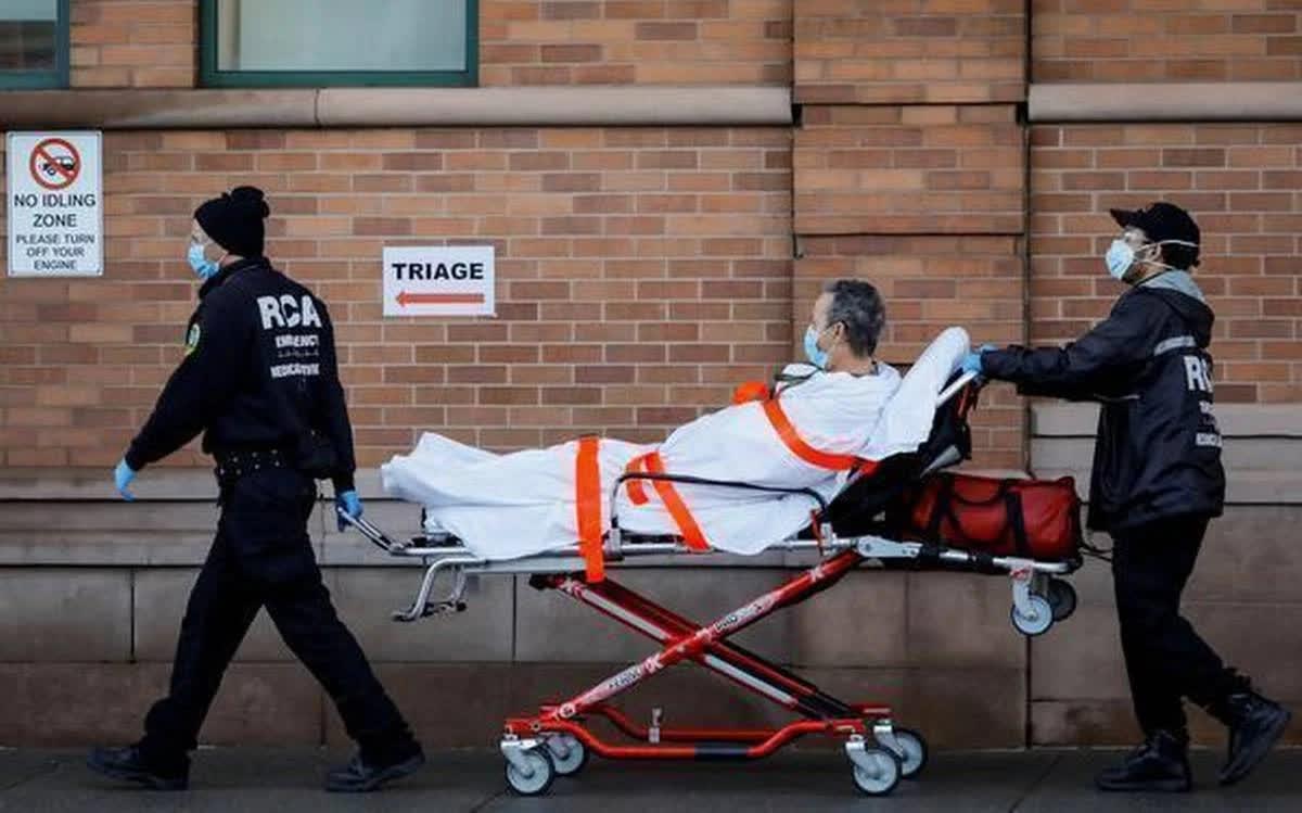 Mỹ: Cứ một phút lại có một người chết vì COVID-19 - Ảnh 1