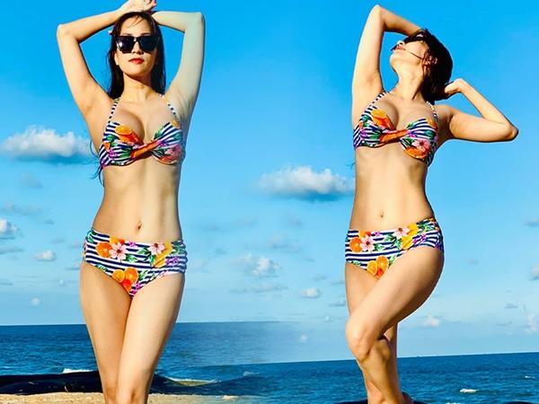 """Khánh Thi diện bikini khoe body cực quyến rũ, """"1 nách 2 con"""" mà vòng eo vẫn săn chắc đáng ngưỡng mộ"""