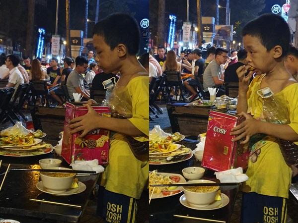 Chạnh lòng bức ảnh cậu bé lem luốc nhặt thức ăn thừa để qua cơn đói: 'Cùng là con người sao con khổ thế?'