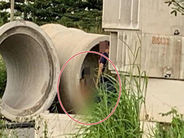 Clip cô gái xinh đẹp trần trụi trong ống cống giữa thanh thiên bạch nhật ở Sài Gòn để chụp ảnh gây tranh cãi
