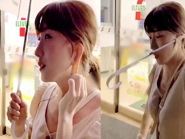 Cô gái xinh đẹp sở hữu chiếc tai kỳ lạ có thể kéo dài và cuốn cả chiếc dù để che nắng mỗi khi 2 tay bận xách đồ