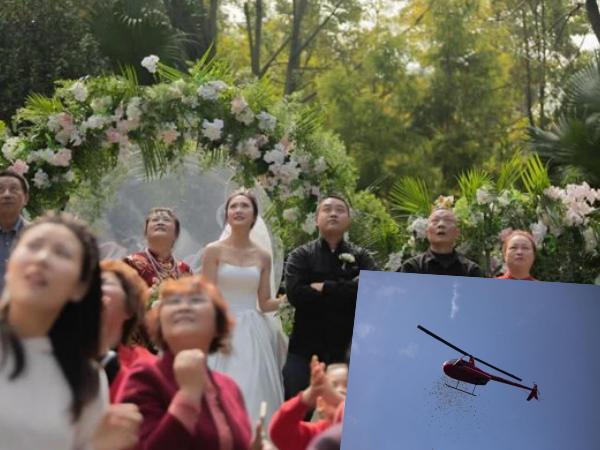 Màn 'chơi trội' chưa từng có: Chú rể dùng máy bay rải phong bì từ trên trời xuống tặng cô dâu và khách mời