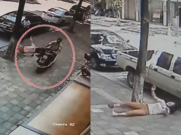 Trên đường ra tòa ly hôn, chồng lái xe tông vợ văng ra đường rồi cầm dao truy sát