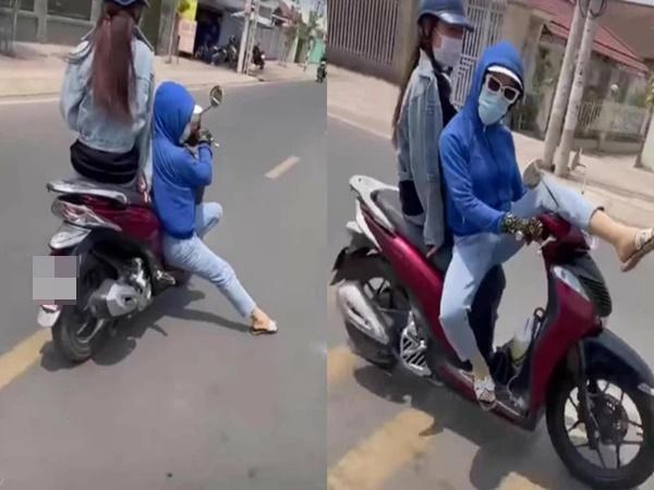 Nữ 'Ninja' uốn éo, 'đi đường quyền' khi đang chạy xe khiến nhiều người khiếp đảm - Ảnh 1