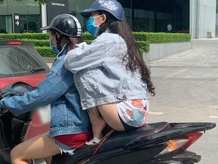 """Cô gái ngồi xe máy chẳng thà làm hành động nguy hiểm chứ nhất quyết không để cặp đùi bị cháy nắng khiến dân mạng """"ném đá"""" không thương tiếc"""