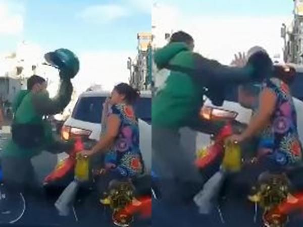 Va chạm giao thông rồi đánh nhau, nam thanh niên dùng nón bảo hiểm đập thẳng vào đầu người phụ nữ