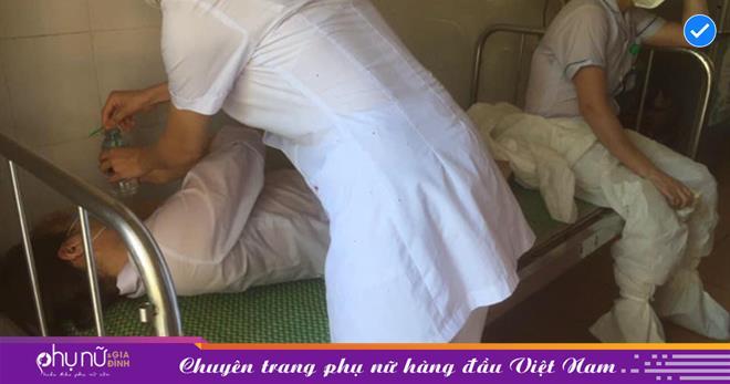Nữ nhân viên y tế mồ hôi ướt đẫm áo, ngất xỉu khi đang lấy mẫu bệnh phẩm ở 'ổ dịch' Bắc Ninh