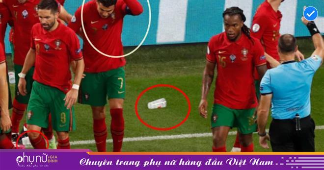 Đang ăn mừng chiến thắng, Ronaldo bất ngờ ôm đầu trở lại sân cỏ vì bị 'vật thể lạ' phang trúng đầu
