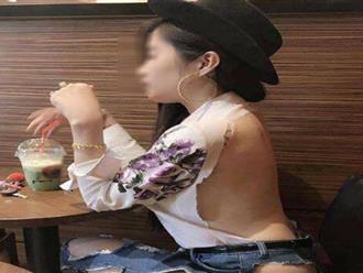 Mỹ nữ mặc đồ rách quá nửa ngồi uống trà sữa gây bão Facebook