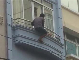 Sốc: Thanh niên nghi phê ma túy leo nhà cao tầng ở phố Tây
