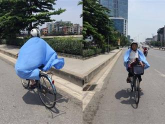 Người Hà Nội quấn chăn, quần áo kín mít tránh nắng nóng kỷ lục trong 40 năm qua