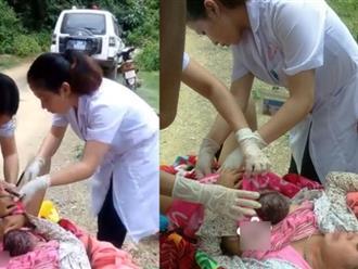 Xôn xao hình ảnh bác sĩ đỡ đẻ ngay giữa đường do sản phụ đau quằn quại, bé gái đã nhô đầu