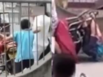Clip gây phẫn nộ: Bé trai bị mẹ buộc dây vào cổ, bố trói tay chân vào xe máy kéo đi giữa đường