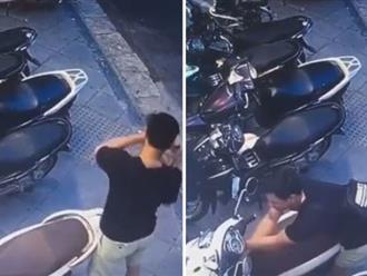 Trộm ngang nhiên bẻ khóa xe tay ga ngay trước mặt nhiều người