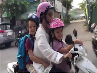Ca sĩ Hồng Nhung lái xe máy đưa hai con đi học