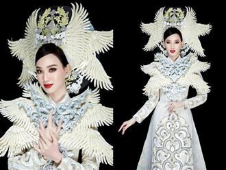 Ái Nhi trình diễn áo dài nặng 30 ký của NTK Minh Châu tại Miss Intercontinental 2021