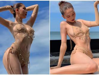 Ngọc Trinh mặc bikini chỉ che phần nhạy cảm, lại còn chú thích: 'Anh có thể làm ướt mọi thứ trên người em'.