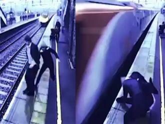Clip chàng trai lao đầu vào xe lửa tự tử nghi do thất tình, may mắn được cô gái lạ cứu sống