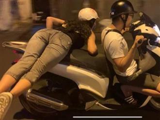 Clip: Cô gái nằm vắt vẻo trên xe máy để bạn trai chở giữa đường gây bức xúc