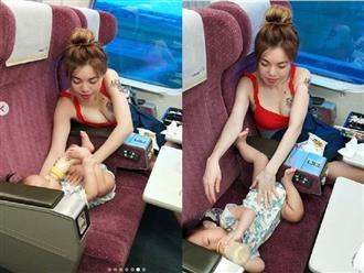 Cho con uống sữa trên tàu, mẹ trẻ gây bão mạng vì sở hữu thân hình quá nóng bỏng