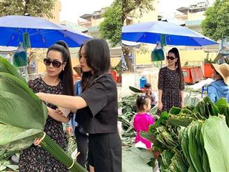 Ngẩn ngơ với loạt ảnh tuyệt đẹp của mẹ con Á hậu Trịnh Kim Chi giữa chợ lá dong