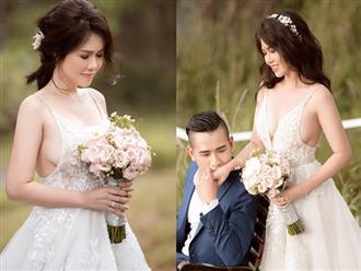 Hé lộ ảnh cưới gợi cảm 'bỏng mắt' của chị gái Ngọc Trinh và chồng thứ hai
