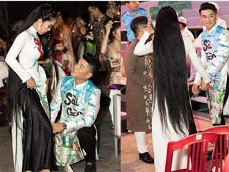 Lê Phương khoe tóc dài chấm gót, được chồng trẻ quỳ gối mang giày giữa chốn đông người